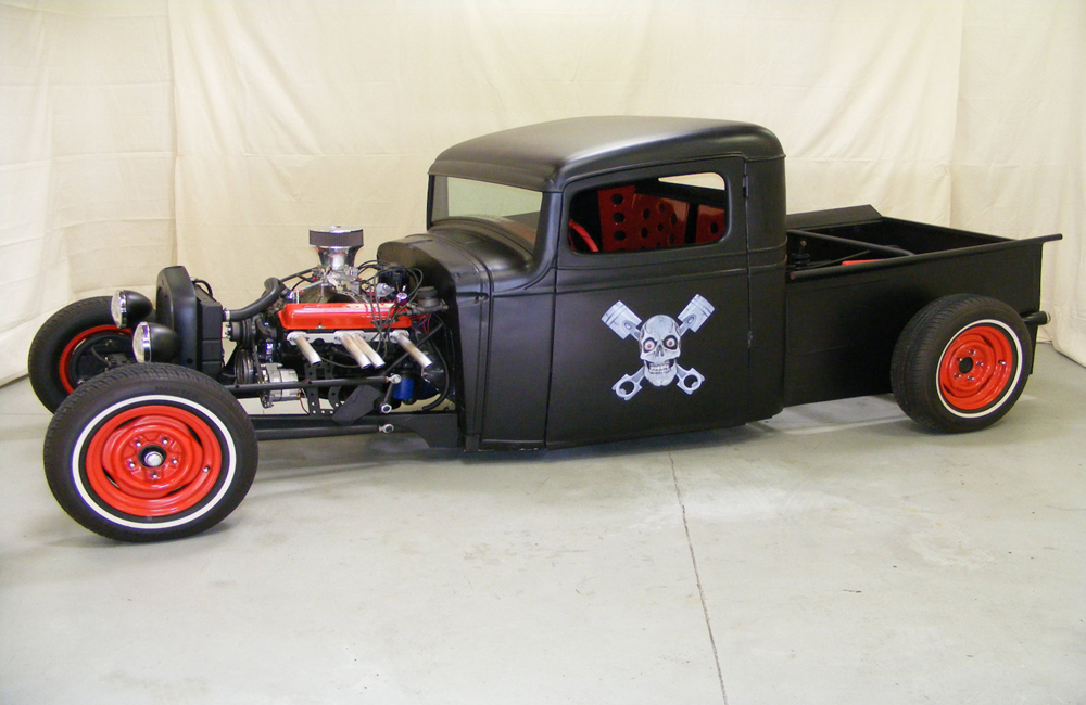 Here s a 1934 rat rod pickup i addedsome skulls with crossed pistons